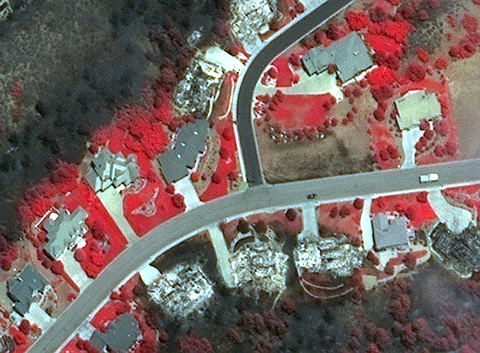 DigitalGlobe's satellite imagery has diverse uses, including disaster monitoring. Google has incorporated imagery of Colorado's Waldo Canyon Fire (above) into its Crisis Map so citizens and disaster management personnel can check on the status of neighborhoods and homes. Image (c) 2012 DigitalGlobe, Inc.